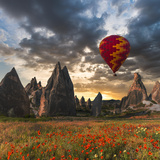 Hot Air Balloon Flying over Red Poppies Field Cappadocia Region, Turkey Photographic Print by Tetyana Kochneva