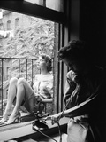 Model Jean Patchet Seated on a Fire Escape, Talks with Eileen Ford, New York, NY, 1948 Photographic Print by Nina Leen