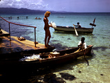 December 1946: Woman and Fishermen at Doctor's Cave Beach in Montego Bay, Jamaica Photographic Print by Eliot Elisofon