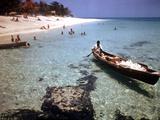 1946: Sam Cunningham Sells Sea Shells to Tourist Along the Seashore in Montego Bay, Jamaica Photographic Print by Eliot Elisofon