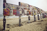 Display of Posters Mounted on Pilings in the Sand, Montauk Point, Long Island, New York, 1967 Photographic Print by Henry Groskinsky