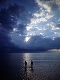 December 1946: Children Wading in the Water During a Late Afternoon Storm at Montego Bay, Jamaica Photographic Print by Eliot Elisofon