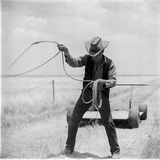 American Actor James Dean Twirls a Lasso on the Set of the Film 'Giant', Near Marfa, Texas, 1956 Photographic Print by Allan Grant