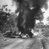Buring Diesel Truck on the Ledo Road, Burma, July 1944 Photographic Print by Bernard Hoffman