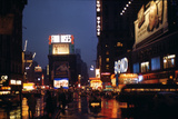1945: Times Square at Night after Rain, New York, NY Photographic Print by Andreas Feininger