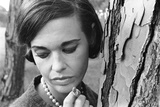 Gloria Vanderbilt Smoking Outside and Showing New Hairdo, 1963 Photographic Print by Paul Schutzer