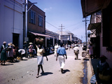 December 1946: Passersby at Market Street in Montego Bay, Jamaica Photographic Print by Eliot Elisofon