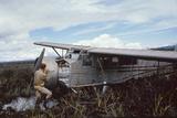 Aviator Roland Angel Repaints His Father's Flamingo Monoplane, Auyantepui, Venezuela, 1965 Photographic Print by Carl Mydans
