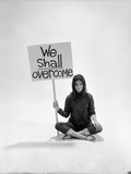 "Studio Photos of Gloria Steinem Sitting on Floor with Sign That Says 'We Shall Overcome"", 1965 Photographic Print by Yale Joel"