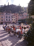 Sidewalk Cafe Sitters Taking in the Evening Sun at Portofino, Italy Photographic Print by Ralph Crane