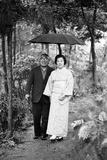 Couple Pose for Portrait in the Rain, Tokyo, Japan, 1967 Photographic Print by Takeyoshi Tanuma