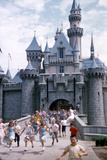 July 17 1955: Sleeping Beauty's Castle Overrun by Children at Disneyland Park, California Photographic Print by Loomis Dean