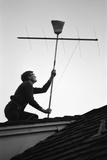 1967: Man Using a Broom to Improve the Antennae Reception During the Broadcast of Super Bowl I Photographic Print by Bill Ray