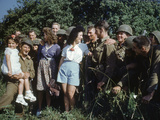 U.S. Soldiers Gather around a French Girl Near Avranches, France, August 1944 Photographic Print by Frank Scherschel