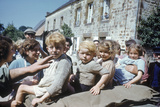 French Children in the Town of Avranches Sitting on Us Military Jeep, Normandy, France, 1944 Photographic Print by Frank Scherschel