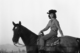 Lee Archer, 24, Riding a Horse at O.B. Llyod Stables in Scottsdale, Arizona, October 1960 Photographic Print by Allan Grant