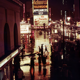 1945: Rainy Night in Times Square with Neon and Billboards, New York, NY Photographic Print by Andreas Feininger