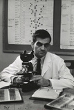 Cancer Specialist Dr. Ernest L. Wynder at Microscope in His Office, 1957 Photographic Print by Alfred Eisenstaedt