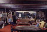 Floating-Home Owner Warren Owen Fonslor with Two Men in His Living Room, Sausalito, CA, 1971 Fotodruck von Michael Rougier