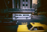 Poster of a Greyhound Bus in Front of Radio City Music Hall, New York, New York, Summer 1967 Photographic Print by Yale Joel