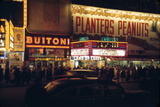 1945: Embassy Theater Showing Newsreel Format Films at Night, Times Square, New York, NY Photographic Print by Andreas Feininger
