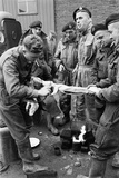 Members of the British 49th Armoured Personnel Carrier Regiment Skin a Rabbit for a Meal Photographic Print by George Silk