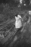 Nurse Maude Callen Carrying Her Medical Bag Along a Muddy Road after Caring for a Patient, 1951 Photographic Print by W. Eugene Smith