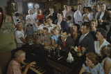Low-Angle View of a Group of People as They Sing Along with a Pianist in a Unidentified Bar, 1959 Photographic Print by Yale Joel