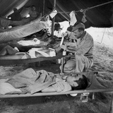 Lew Ayres Treating Wounded Japanese Prisoner in Leyte Cathederal Turned into Hospital, 1944 Photographic Print by W. Eugene Smith