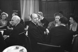 French Designer Christian Dior Drinking with Unidentified Others at a Bar, Paris, November 1947 Photographic Print by Frank Scherschel