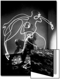 Multiple Exposure of Artist Pablo Picasso Using Flashlight to Make Light Drawing of a Figure Posters by Gjon Mili