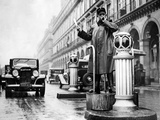 Traffic Policeman in Paris, 1936 Photographic Print by  Süddeutsche Zeitung Photo