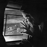 A Stewardess Looking Through an Airplane Window, 1938 Photographic Print by Scherl Süddeutsche Zeitung Photo
