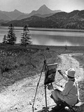 A Woman Is Painting at the Weißensee Near Füssen, 1934 Photographic Print by Knorr Hirth Süddeutsche Zeitung Photo