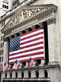 The facade of the New York Stock Exchange draped in the American Flag Stretched Canvas Print
