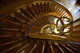 Looking Down a Spiral Staircase Past a Hanging Chandelier Lærredstryk på blindramme af Amy & Al White & Petteway