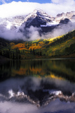 Maroon Bells with Fog and Autumn Aspens Reflected in Maroon Lake Stretched Canvas Print by Keith Ladzinski