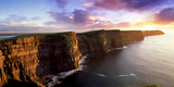 Sunset on the Cliffs of Moher, County Clare, Ireland Stretched Canvas Print by Chris Hill