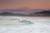 Long Exposure of Surfers Enjoy the Wave on Praia Da Joaquina Beach Photographic Print by Alex Saberi