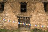 Prayer Flags in Front of the Drukgyal Dzong in Paro Bhutan Photographic Print by Ira Block