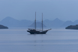 A Pinisi Sailing Vessel Off the Coast of Rinca Island, Komodo National Park, Indonesia Photographic Print by Jeff Mauritzen