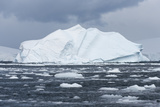 An Iceberg Floats in Fournier Bay, Antarctica Photographic Print by Jeff Mauritzen
