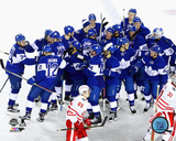 The Toronto Maple Leafs celebrate winning the 2017 NHL Centennial Classic Photo