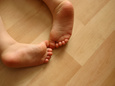 Cute Chubby Baby Feet on Wooden Flooring Photographie
