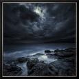 Black Rocks Protruding Through Rough Seas with Stormy Clouds, Crete, Greece Lámina fotográfica enmarcada