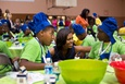 First Lady Michelle Obama Talks with Kids Making Trail Mix at the Mcalpine Park, Alabama Photo
