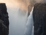 Africa, Zimbabwe, Victoria Falls. Close-Up of Waterfall and Spray at Sunrise