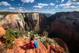 A Female Hiker Takes In The Dramatic Views Form Observation Point In Zion National Park, Utah