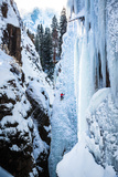 An Ice Climber Ascends A Route In Ouray, Colorado