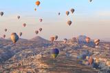 Turkey, Anatolia, Cappadocia, Goreme. Hot air balloons above Red Valley.